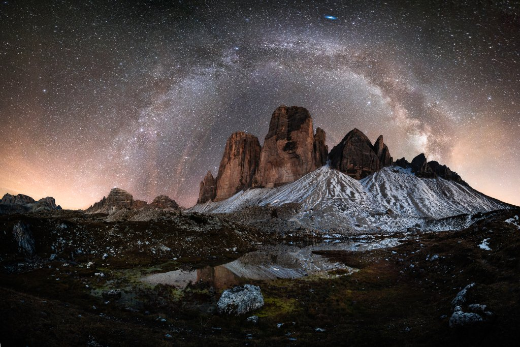The Tre Cime di Lavaredo peak emerging and touching the sky crating a trairway to the gates of heaven Lionel Favre Italien, lavaredo,